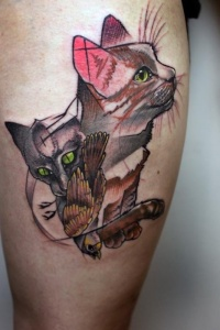 Cat and bird abstract tattoo