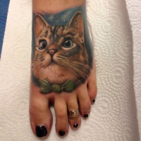 Cat tattoo on foot