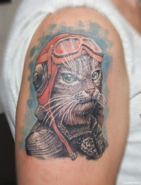 Colorful cat pilot tattoo on shoulder