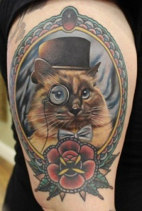 Coloured gentlemen cat tattoo by Phatt German