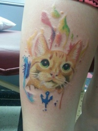 Cool watercolor cat tattoo