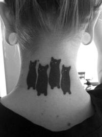 Cute black cats tattoo on neck
